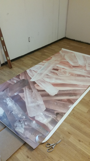 cutting the panels of the crystal mural from Anna Fell at https://www.muralswallpaper.co.uk/